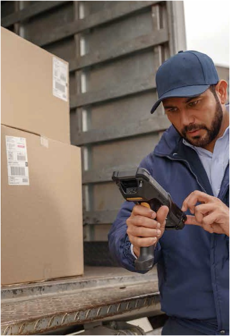 Worker scanning packages in a truck