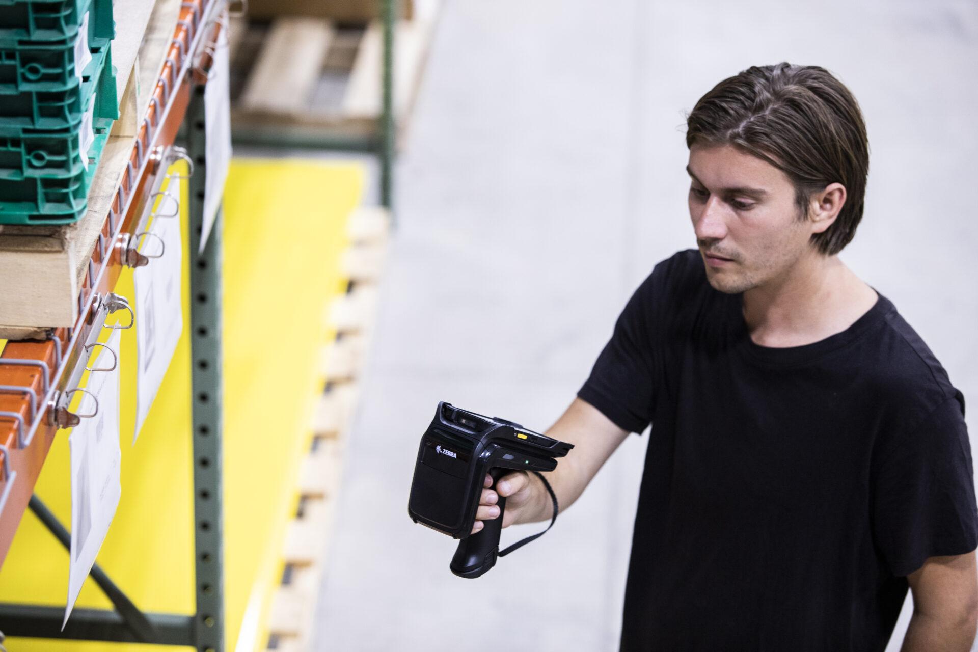 Worker using RFID scanner